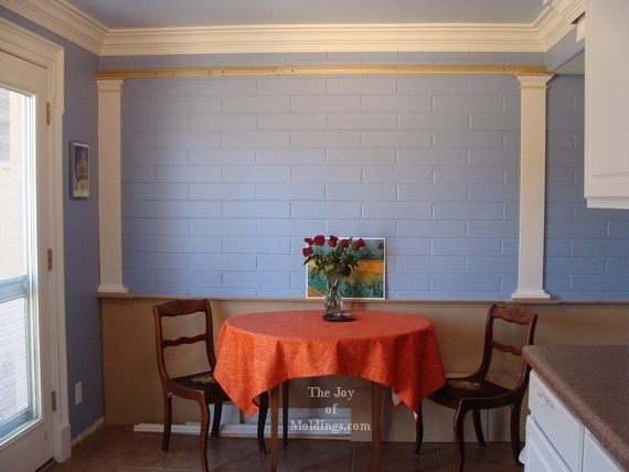 kitchen with blue walls and diy wainscoting