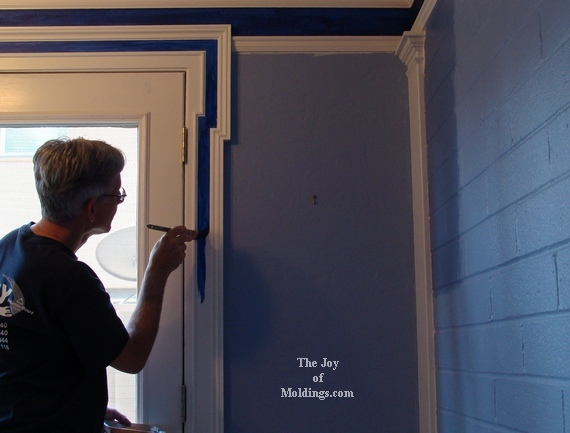 painting door trim wite and blue in kitchen