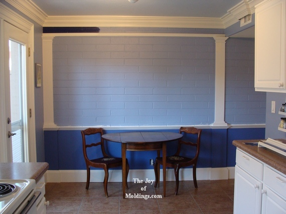 wainscoting on kitchen brick wall