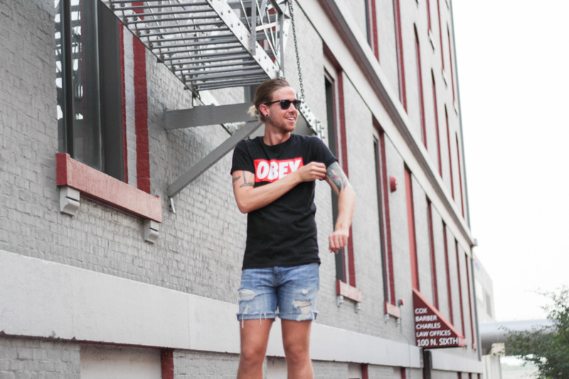 The Kentucky Gent in Obey T-Shirt, Levi's Cut Off Shorts, Converse Chuck Taylors, and Ray-Ban Liteforce Wayfarers.