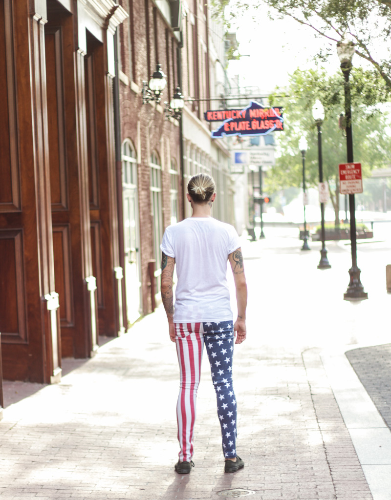 The Kentucky Gent in Kill City American Flag Jeans, BDG V Neck Tee, and Converse Chuck Taylors.