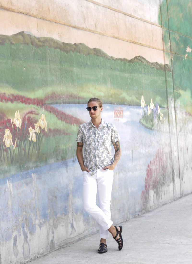 The Kentucky Gent in Spy Optic Sunglasses, Kennington Paisley Shirt, H&M White Twill Pants, and Zara Sandals.