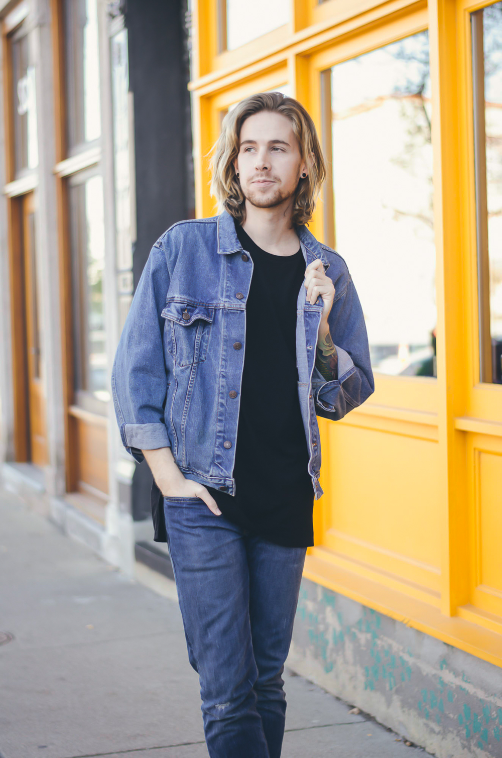 The Kentucky Gent, a men's fashion and lifestyle blogger, in Zanerobe Flintlock T-Shirt, Levi's 511 Jeans, Levi's Denim Jacket, Richer Poorer Socks, Ray-Ban Aviator Sunglasses, and CAT Footwear boots.
