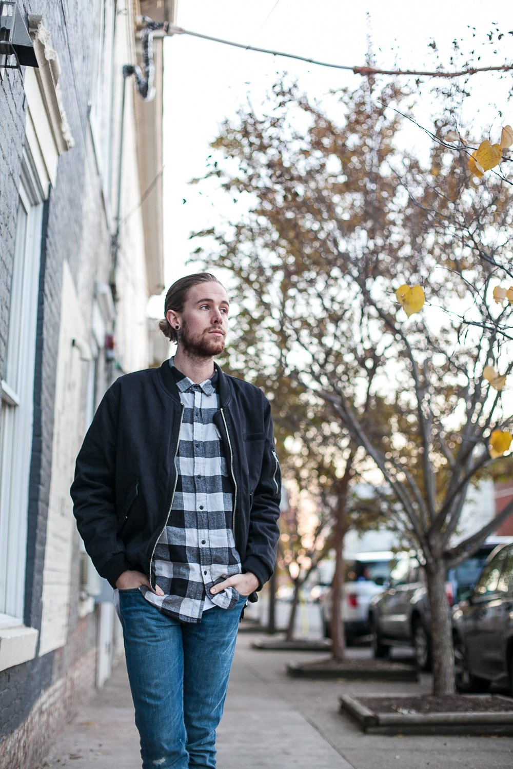 The Kentucky Gent, a Louisville, Kentucky life and style blogger, in Salt Valley Plaid Shirt, Cheap Monday Bomber Jacket, Levi's 511 Jeans, Trask Union Boots, and Richer Poorer Socks.