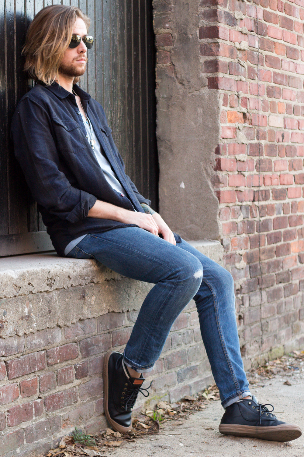 The Kentucky Gent, a Louisville, Kentucky men's fashion and life style blogger, in Katin Plaid Shirt, BDG Henley Tee from Urban Outfitters, Levi's 511 Jeans, Volley High Top Sneakers, and Ray-Ban Aviator Sunglasses.