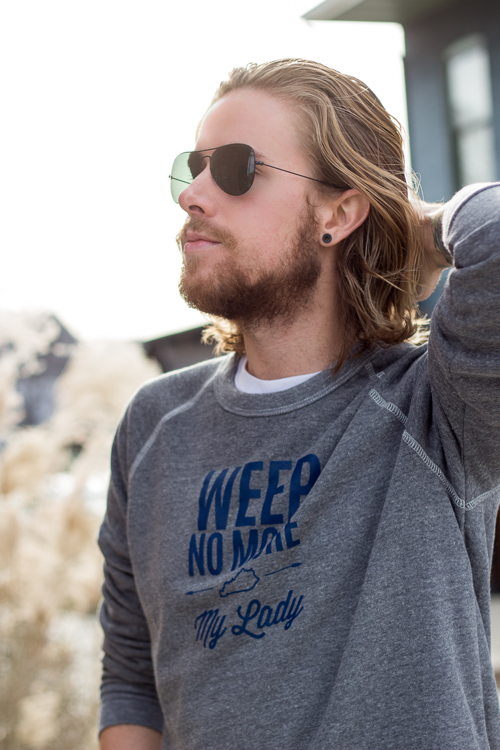 The Kentucky Gent, a Louisville, Kentucky men's life and style blogger, in Shop Local KY Weep No More My Lady Sweatshirt, Levi's Made and Crafted Denim, Converse Chuck Taylors, and Ray-Ban Aviator Sunglasses.