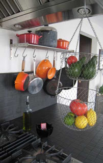 pots and pans hanging on the wall