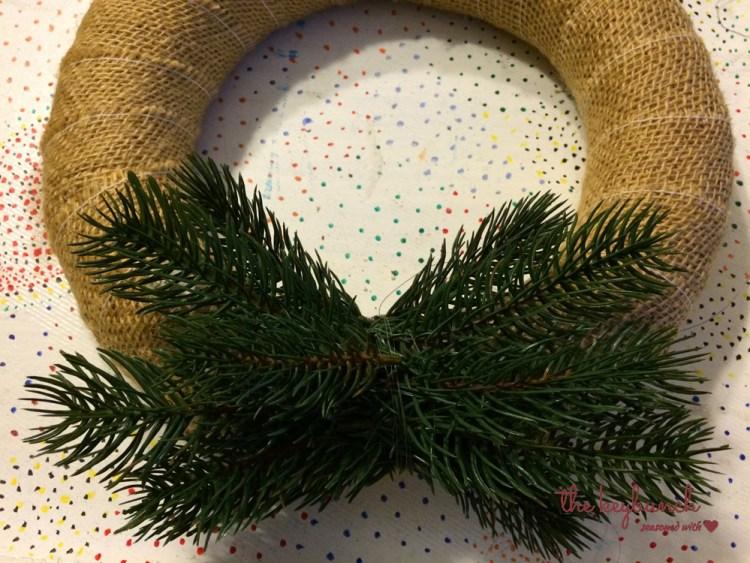 Wrap the straw wreath with burlap