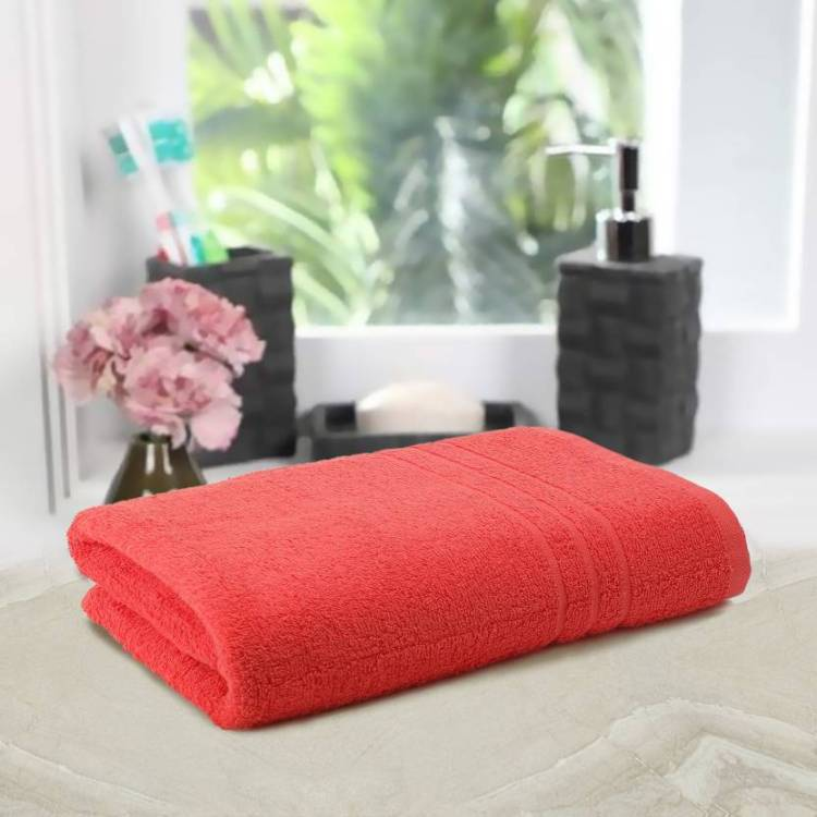 A fresh flowers and bath towel in peach color, a great way to decorate bath spaces