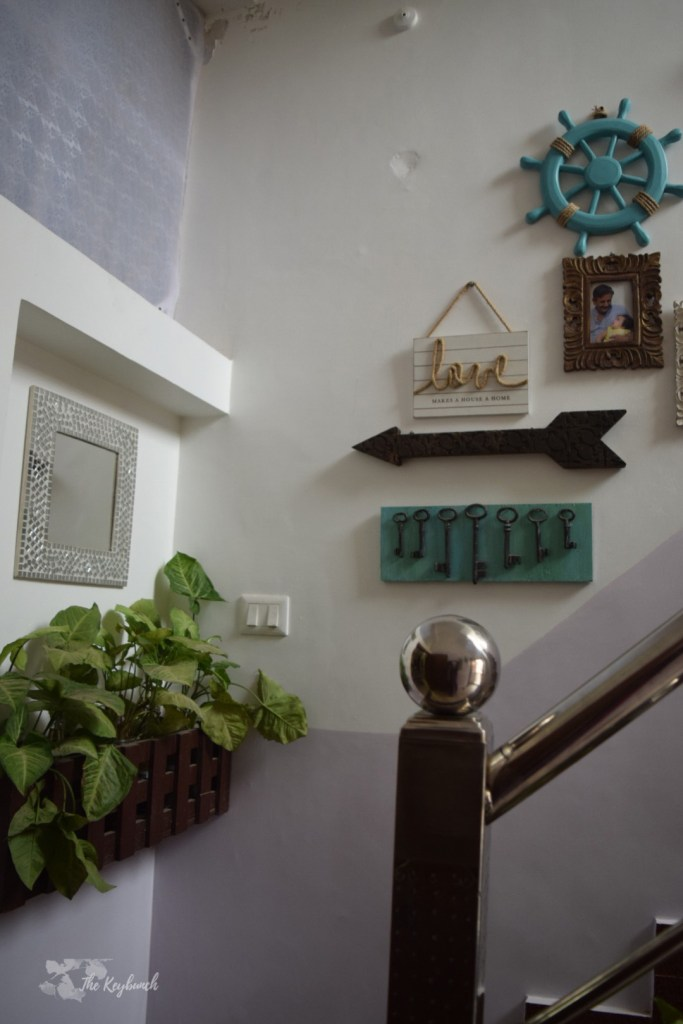 Home decor Tour by Ankita and Sitanshu's in Lucknow - The stairway decorated with green plants and gallery wall