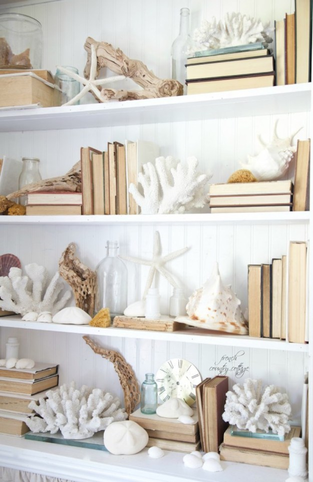 beach inspired bookself that is white and light colors
