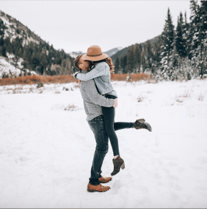 Couple Kissing in a winter wonderland - Chicago winter date night ideas