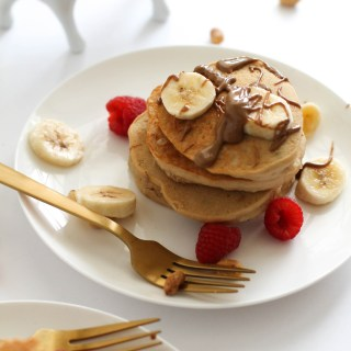 These peanut butter pancakes are fluffy, vegan, gluten free, and full of flavor. They're naturally sweet and require one bowl, which makes them the perfect Sunday breakfast. Serve them with some fresh fruit, maple syrup, and enjoy!