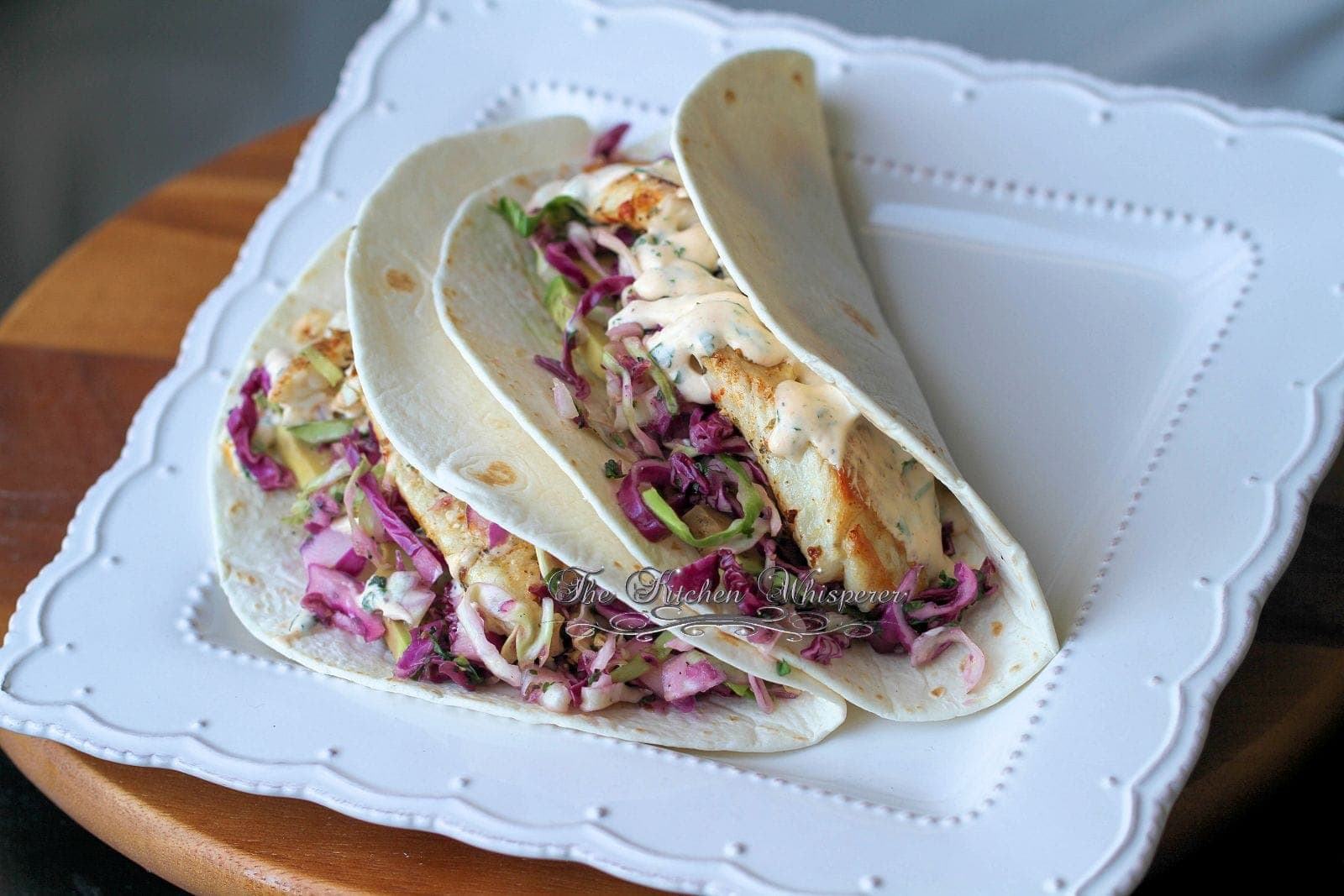 Grilled fish soft tacos with baja cream sauce for Creamy fish taco sauce
