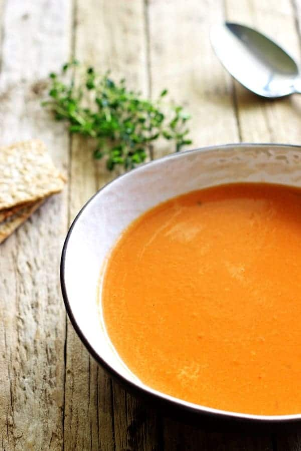 Homemade tomato soup - the ultimate in pre-holiday comfort food. Quick, easy and so satisfying. Perfect for lunch served with grilled cheese! | thekiwicountrygirl.com