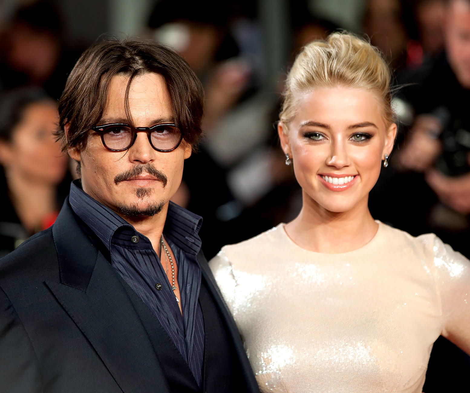 Johnny Depp and Amber Heard get married on Depp's private island, in the Bahamas