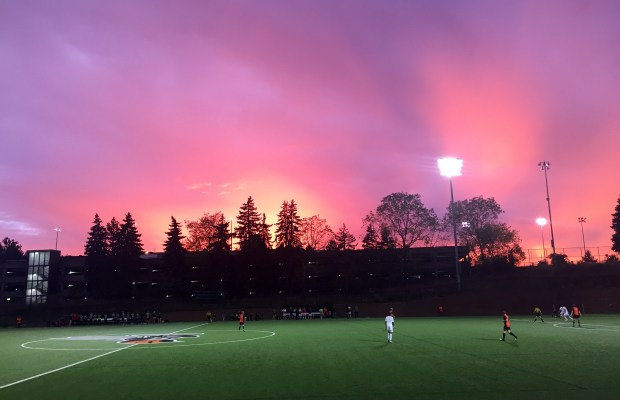 The sun sets over MacKenzie Field as the Hornets are on their way to victory (Rachel Carson / The Index)