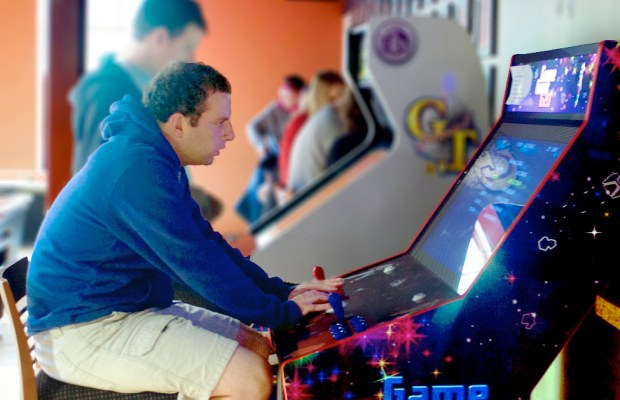 Young adults and K students play arcade games (Rachel Carson / The Index)