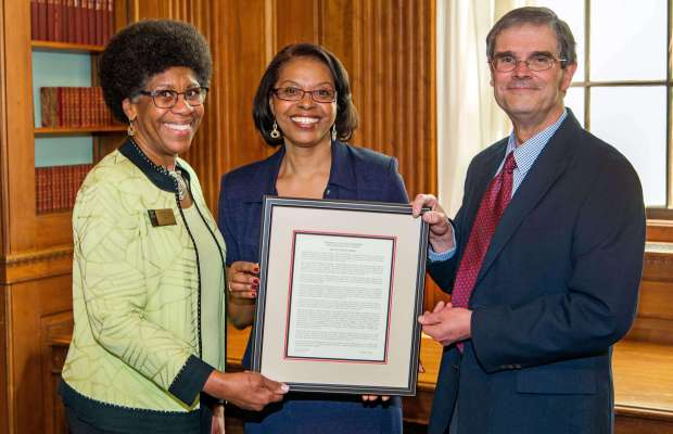 Professor Stevens-Truss receives citation from President Eileen Wilson-Oyelaran and Professor of Chemistry Thomas J. Smith(Photo provided by Anthony Dugal Photography).