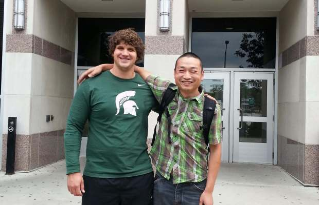 Thomas McLravry with Pengchao Hao, the graduate student he worked with over the summer on his project, in front of the MSU Chemistry Building. Photo courtesy of Thomas McLravry.