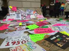 Protest signs lie scattered at a Metro station after the March [Ayla Hull / The Index].