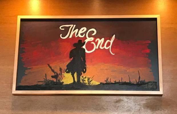 """Darius Gardner's """"The End"""" is the last picture left hanging over the Alamo's front bar (Photo courtesy of Kyle Lampar, K'17)."""