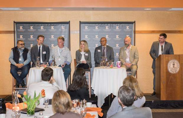 (Left to right) Om Malik, Jeff Wycoff, Val Cole K'83, Lindsey Haswell, Hilmon Sorey, and Michael McFall K'93 discuss their professional calling in panel, introduced by (far right) Brad O'Neill K'93 (Keith Mumma / Kalamazoo College).