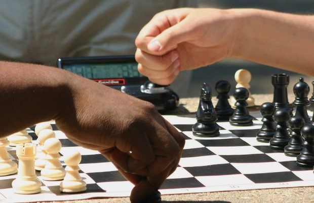 Check Matey (left) and Stolur Bishop (right) playing a game of chess (Photo courtesy of Chess Club/Student Representative member).