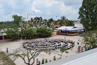 Students celebrating the opening ceremony of the school after the renovation by Angels for Children