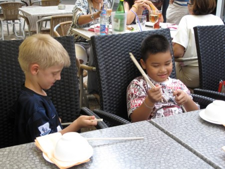 Max and Thonee with their chopsticks