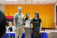 "Phovang ""Noy"" Inthavong (English teacher at Sikeud primary school) receives her certificate"