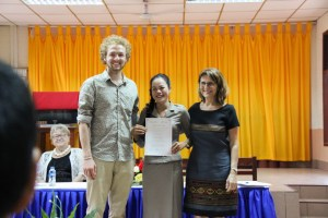 """Phovang """"Noy"""" Inthavong (English teacher at Sikeud primary school) receives her certificate"""