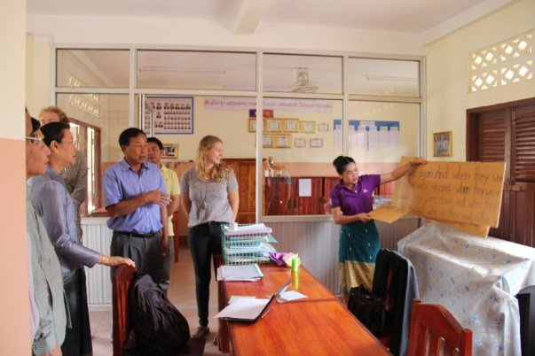 In the teachers' room, Mrs Bounpheng Singhalat shows a poster she uses in her Activities
