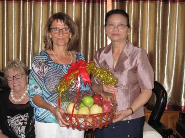 Prof. Martin hands over a fruit basket to H.E. Mrs Sengdeuane Lachantaboune
