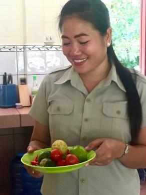Teacher Ms Mit shows the ingredients