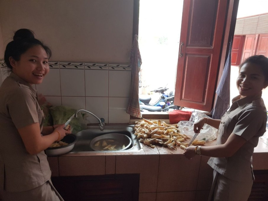Ms Khamsee and Ms Donekeo prepare a bamboo soup
