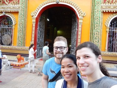 Fabian, Ms Saysamone and Svenja visit a temple in Vientiane