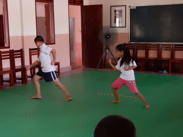 Two pupils of the karate class at Ban Sikeud primary school have a competition