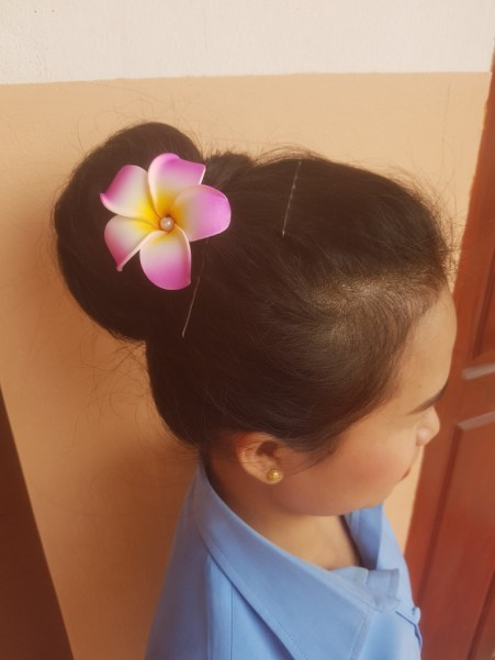 Traditional champa flower as hair ornament