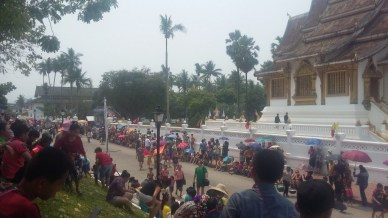 The wait for the parade to begin on the Main Street in Luang Prabang