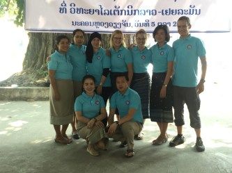 Volunteers and teachers in their new T-Shirts