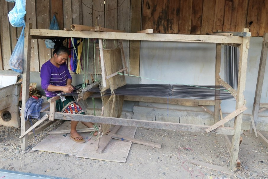 Ms Khamsee's mother on one of their weaving frames