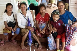 Children with their mother and grandmother at That Luang Festival, Vientiane