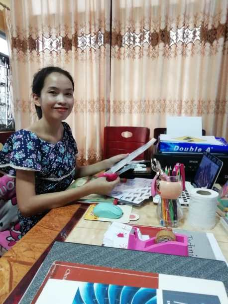 Ms Akina prepares her English lessons at home.