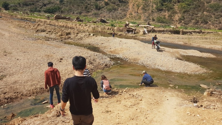 Khampheng, Bounphay, Napathsone, and Mr Sengkeo Alounthong inspect the hot spring in the little mountain village of Houaphan Province.
