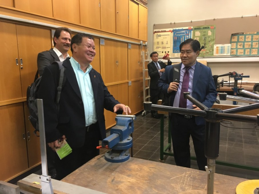 Mr Franz-Martin Walser shows the Technics Room, which seems to revive happy memories for a former Lao student in East Germany.