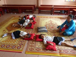 Teacher Mittaphone Sichampa takes care of the little pre-schoolers.