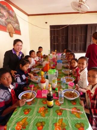 The children enjoy the delicious noodle soup.