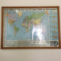 "Old map with new meaning (in front of the VEDI library): ""No half of the world can survive without the other""."
