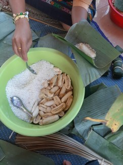 ...wrapping sticky rice and half a banana in a banana leaf...